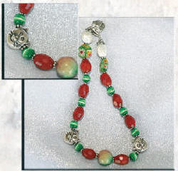 Dog collar made of Red Glass Beads with Green Cat's Eye and Silver Cat Faces